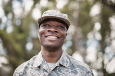 close up of happy military soldier JXKWHD7 scaled