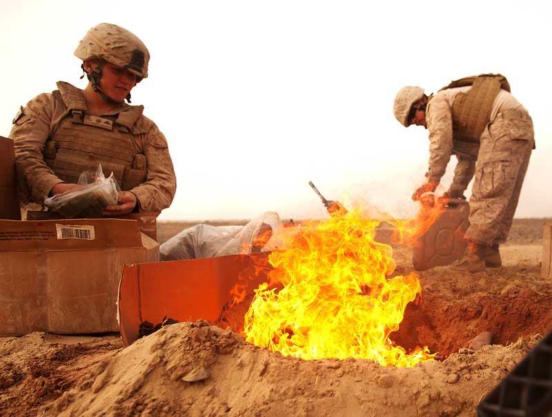 service members working near a flame