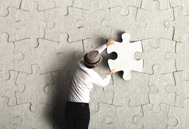 in the puzzle of discrimination against veterans a man wearing a hat places the last puzzle piece