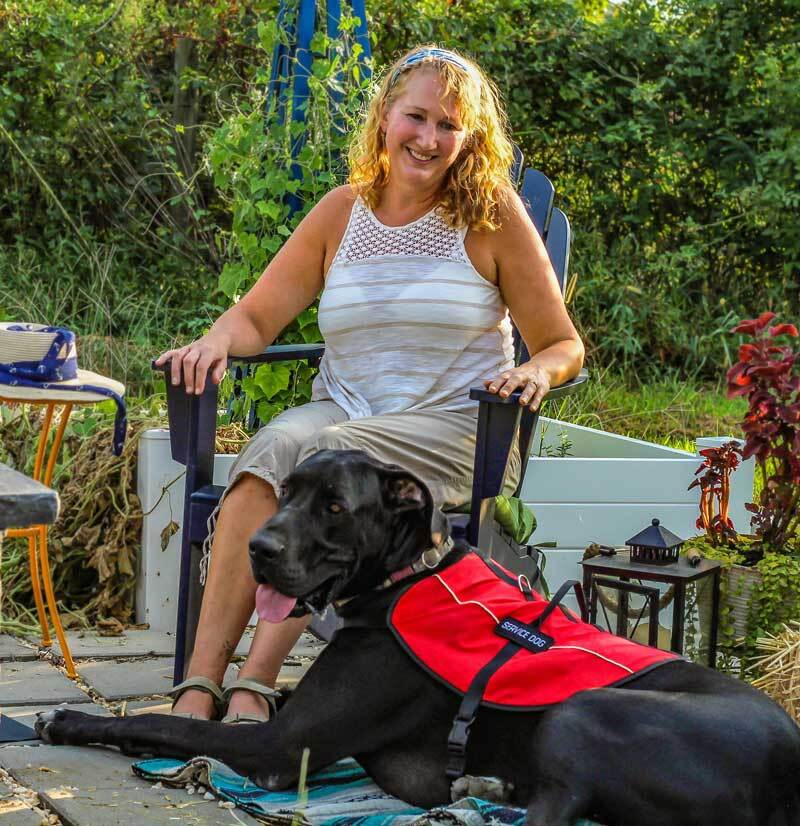 Woman smiles at her service dog