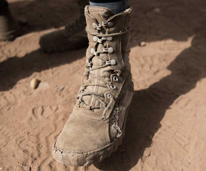 An active duty soldier's boots tied tightly
