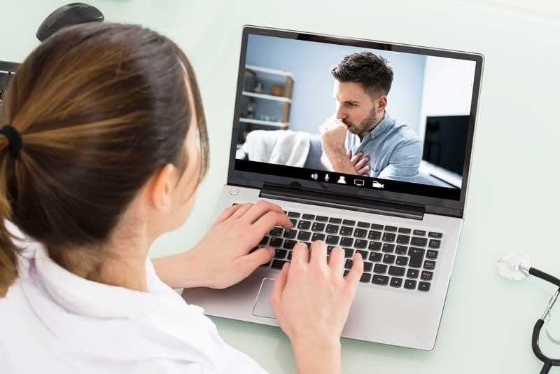 doctor meets with veteran via laptop