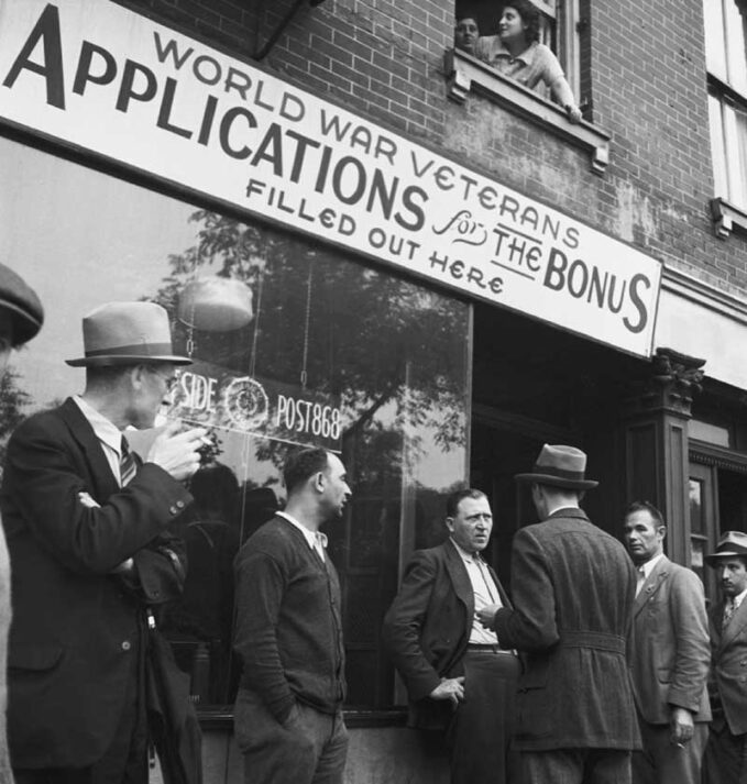 World War Veterans, in black and white, standing in line for applications