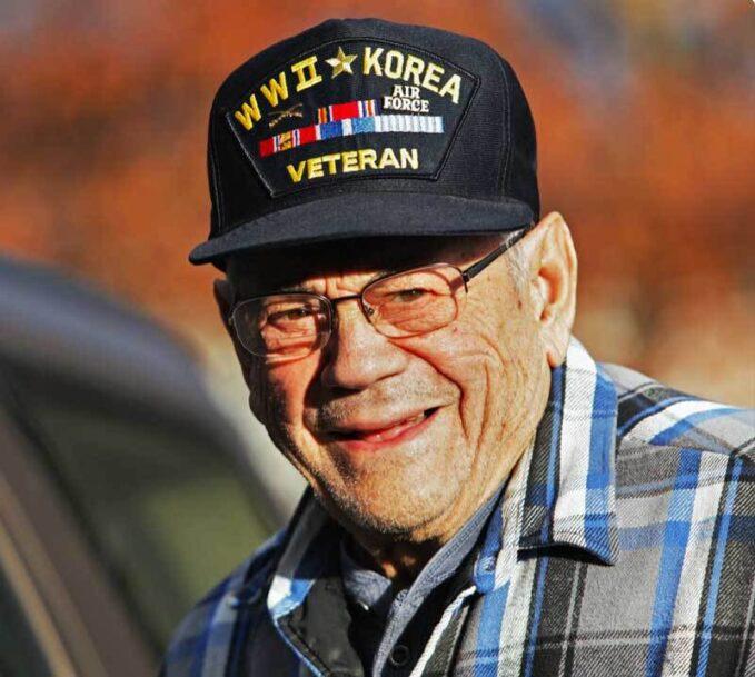 A Korean War Veteran smiles at the camera