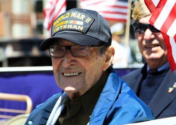 a world war ii veteran smiles at the camera