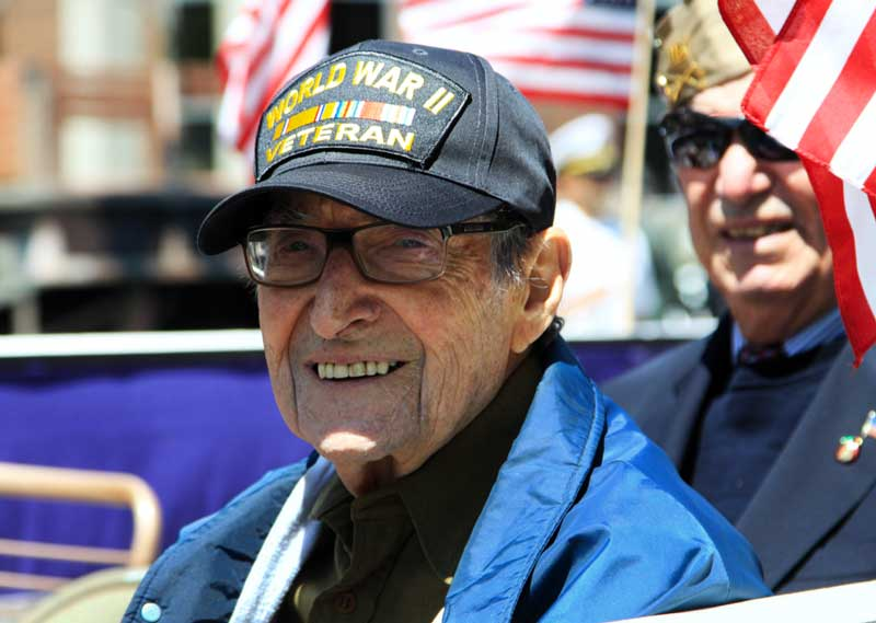 a world war ii veteran smiles at the camera