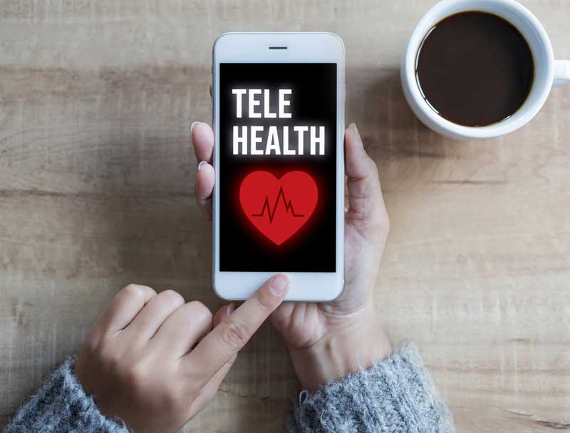 woman ends telehealth session on iphone