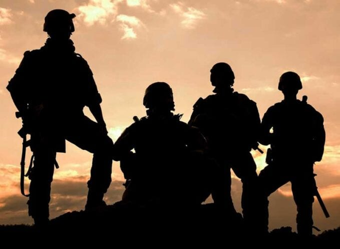 Military service members, pictured in shadow