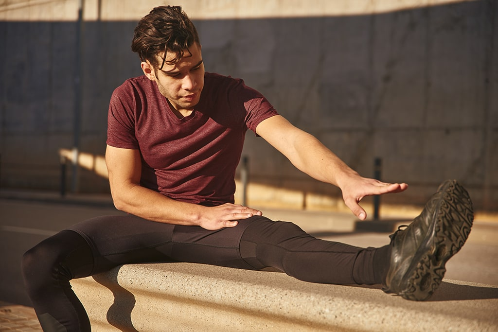 Man Stretching Outside