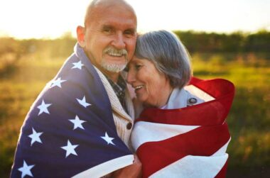 couple wrapped in u.s. flag