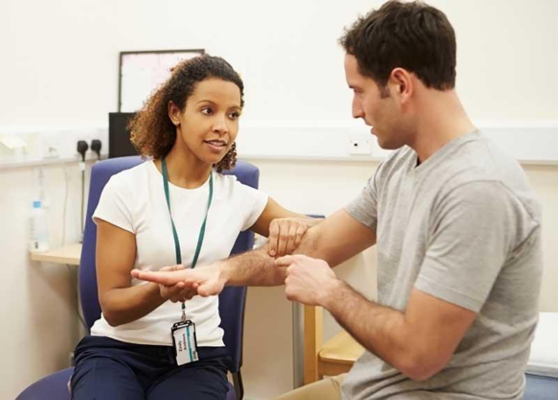 doctor examines veterans arm