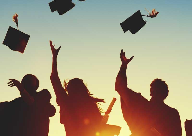 people throw graduation caps