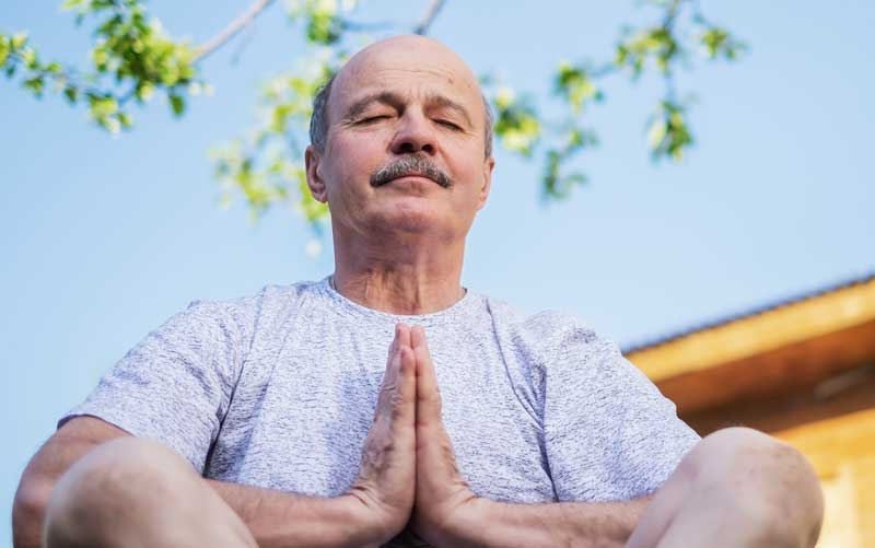 senior veteran meditates